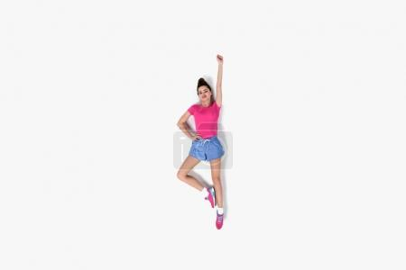 top view of young sportwoman in superhero position isolated on white