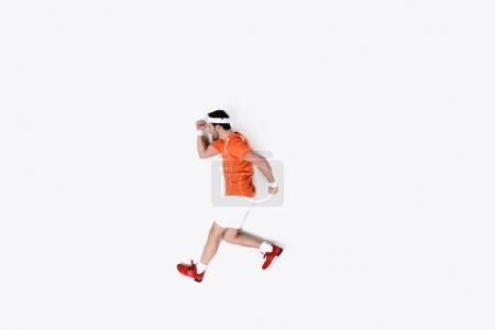 top view of young man in sportswear running isolated on white