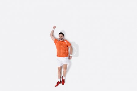top view of young man in sportswear jogging isolated on white