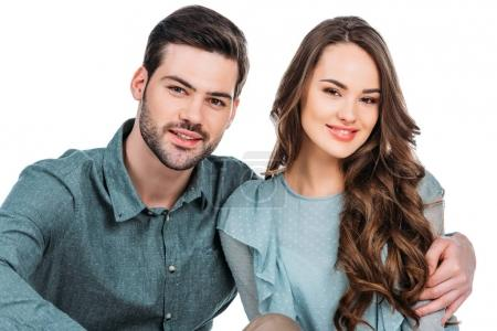 smiling young couple looking at camera isolated on white