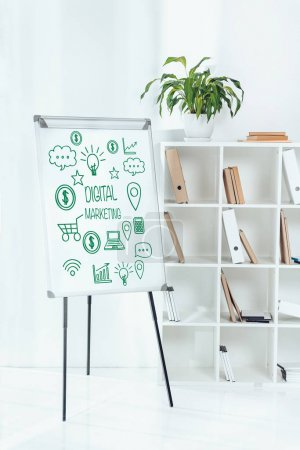 whiteboard with digital marketing symbols and wooden shelves with folders in office