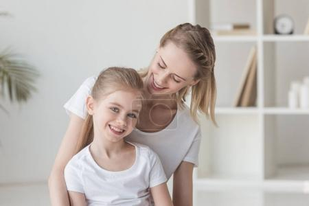 Photo for Happy mother and little daughter spending time together at home - Royalty Free Image