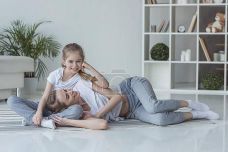 Photo for Happy mother and little daughter relaxing at home together - Royalty Free Image