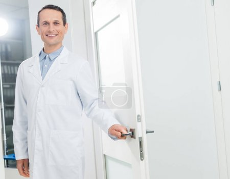 Doctor welcoming patient in modern clinic