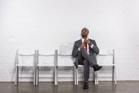 african american businessman in suit waiting for job interview