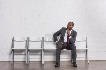 Photo for Pensive african american businessman waiting for job interview - Royalty Free Image