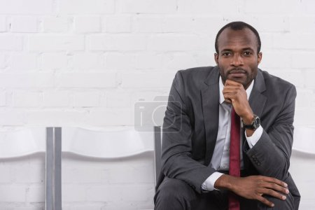 portrait of pensive african american businessman waiting for job interview