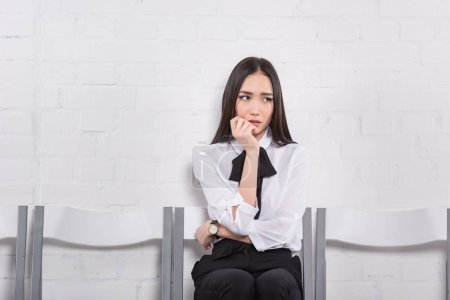 portrait of worried asian businesswoman waiting for job interview