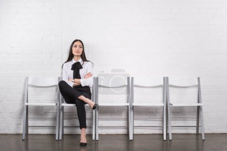 smiling asian businesswoman waiting for job interview