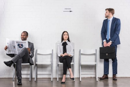 multicultural young business people in formal wear waiting for job interview