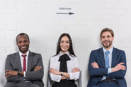 Photo for Portrait of smiling multicultural business people with arms crossed waiting for job interview - Royalty Free Image