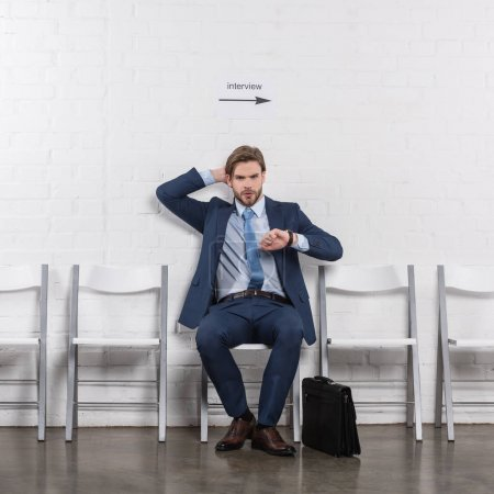 Photo for Pensive caucasian businessman waiting for job interview - Royalty Free Image