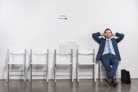 relaxed caucasian businessman waiting for job interview