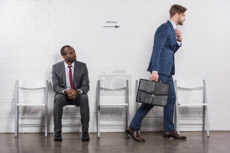 african american businessman looking at caucasian colleague going on job interview