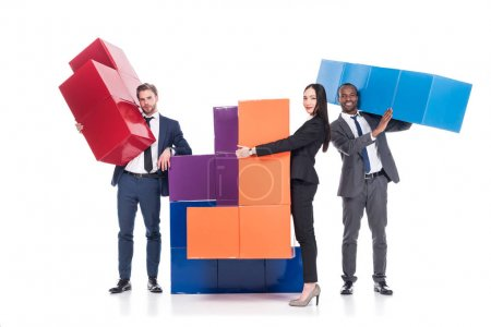 multiethnic business people with colorful blocks isolated on white, business cooperation concept