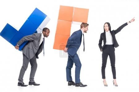 asian businesswoman leading multiethnic colleagues with colorful blocks isolated on white, leadership and business cooperation concept