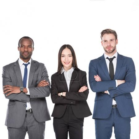 Photo for Portrait of smiling multicultural young business people with arms crossed isolated on white - Royalty Free Image
