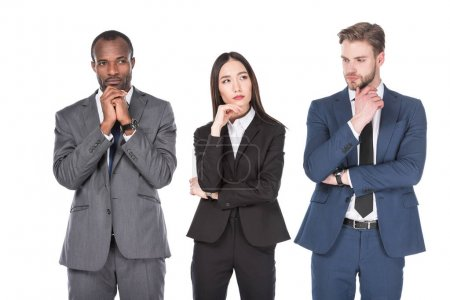portrait of pensive multicultural young business people isolated on white