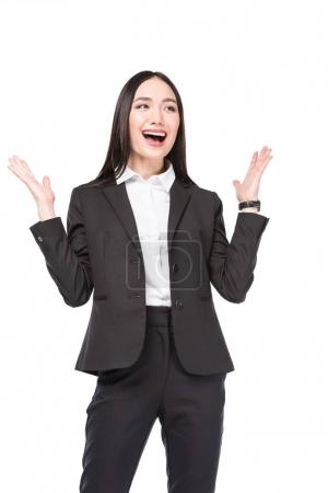 portrait of excited asian businesswoman in suit isolated on white