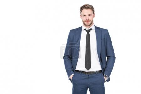 portrait of caucasian businessman in suit with hands in pockets isolated on white