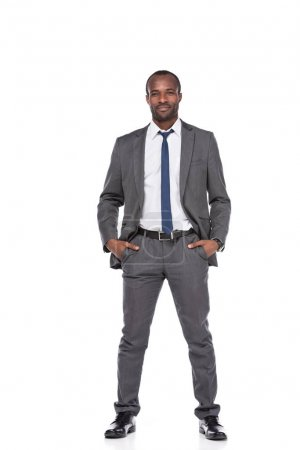 smiling african american businessman in suit isolated on white