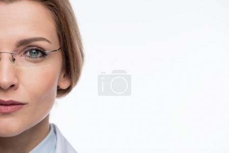 Close-up view of female doctor wearing glasses isolated on white