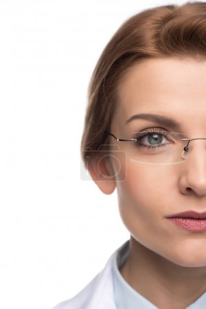 Close-up view of confident female doctor wearing glasses isolated on white