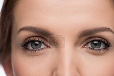 Close-up view of beautiful young woman with grey eyes
