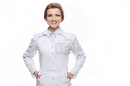 Photo for Young smiling female doctor standing isolated on white - Royalty Free Image