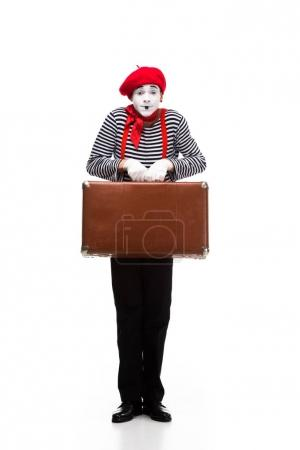 mime holding brown suitcase isolated on white