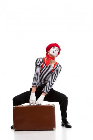 mime lifting up heavy brown suitcase isolated on white