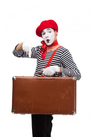 Photo for Mime pointing on brown suitcase isolated on white - Royalty Free Image