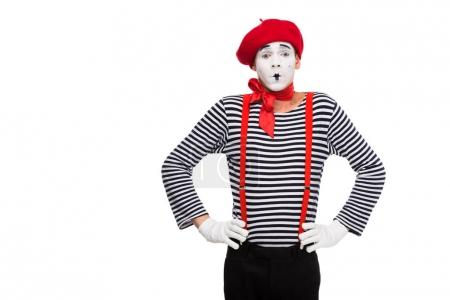 surprised mime standing with hands akimbo isolated on white