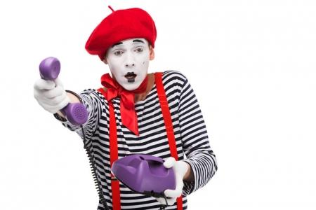 shocked mime giving ultra violet retro stationary telephone isolated on white