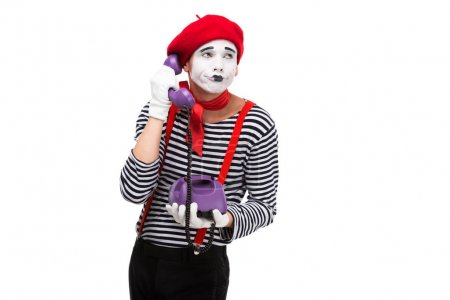 Photo for Skeptical mime talking by ultra violet retro stationary telephone isolated on white - Royalty Free Image