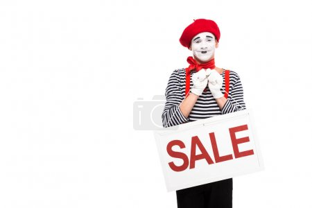 Photo for Smiling mime holding sale signboard isolated on white - Royalty Free Image