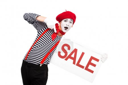 surprised mime pointing on sale signboard isolated on white