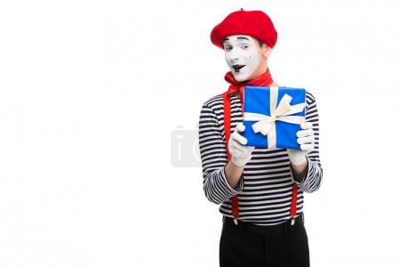 excited mime holding gift box isolated on white