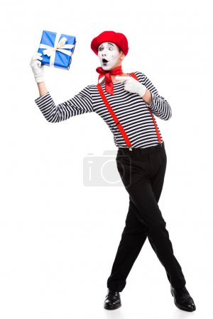 Photo for Surprised mime pointing on gift box isolated on white - Royalty Free Image
