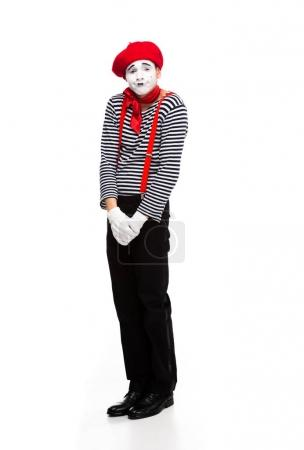 grimacing mime standing isolated on white