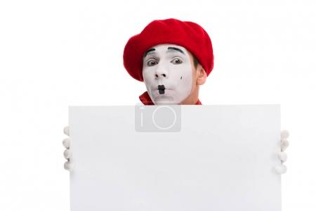 grimacing mime holding empty board isolated on white