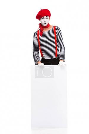 mime standing with empty board isolated on white