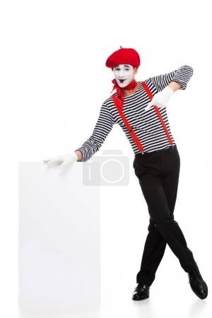 Photo for Cheerful mime pointing on empty board isolated on white - Royalty Free Image