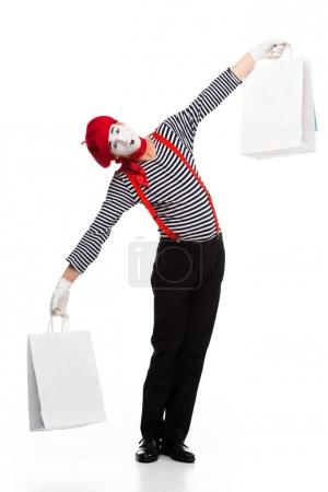 mime holding shopping bags in open arms isolated on white
