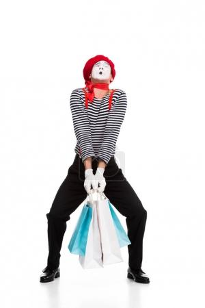 mime carrying heavy shopping bags isolated on white