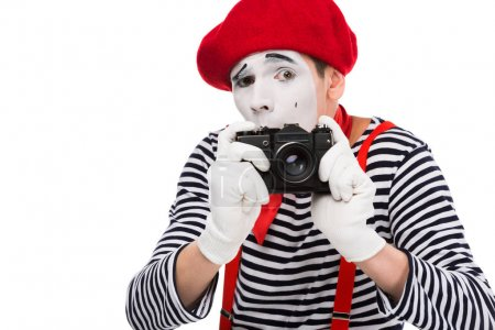 scared mime taking photo with film camera isolated on white