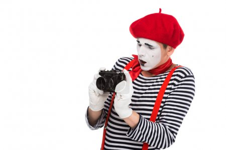 shocked mime taking photo with film camera isolated on white