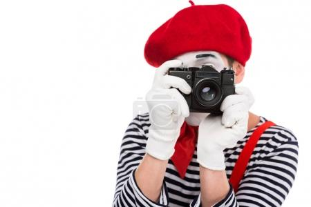 Photo for Mime taking photo with film camera isolated on white - Royalty Free Image