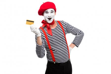 happy mime showing credit card isolated on white