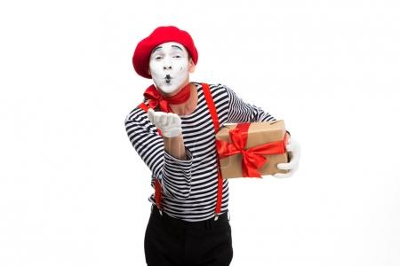 mime holding present box and sending air kiss isolated on white